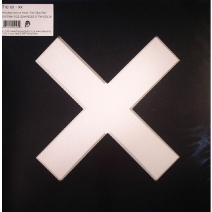 The XX - XX + insert in die cut sleeve